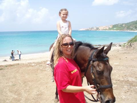 kid on horse back